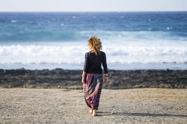 Woman Walking At Beach