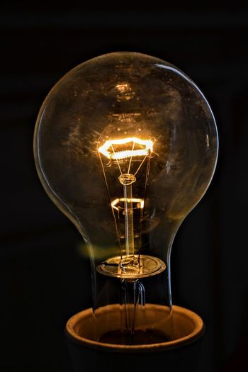Light Bulb Electricity  Lighting Equipment Filament Illuminated Bulb Technology Fuel And Power Generation Glowing No People Close-up Studio Shot Black Background Power Supply Innovation Indoors  Modern Old Filament Light Filament Bulb