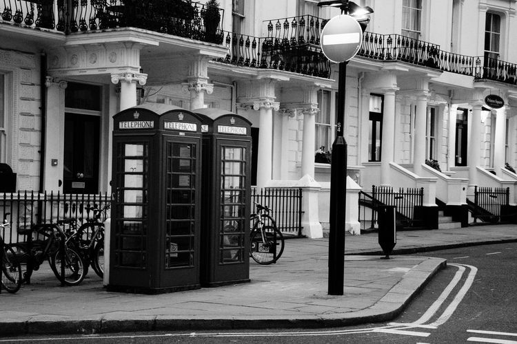 Telephone booths by building in city