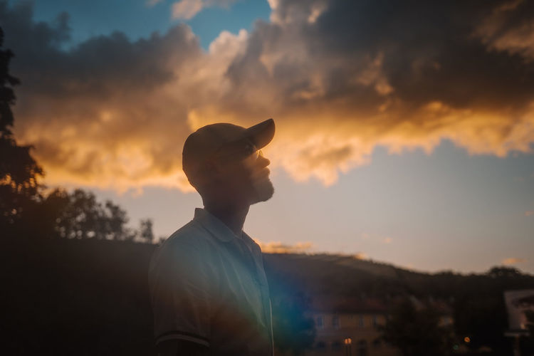 Portrait of silhouette man standing against sky during sunset