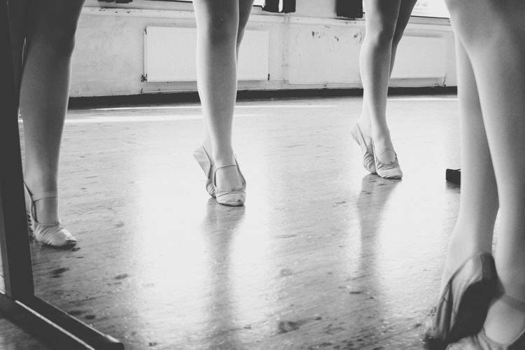 Low section of women practicing in ballet studio