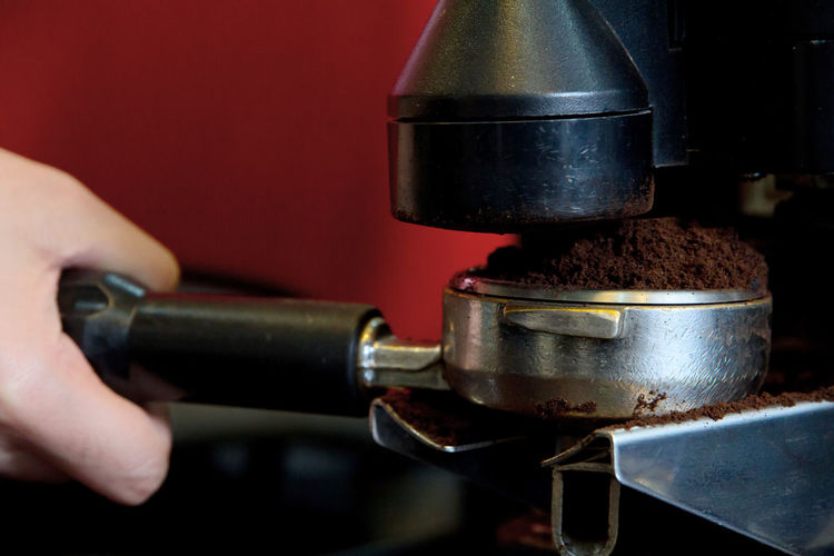 Close-up of person holding coffee pota filter
