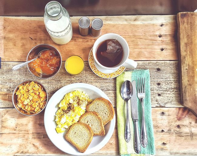 Tea Break Time Breakfast ♥ Breakfast Breakfast Time BreakfastTime  Bottle Of Milk Milk Mermelada Sweet Food Cereal Egg Bread Toast🍞 Fork Knife Spoon Wooden Table My Favorite Breakfast Moment