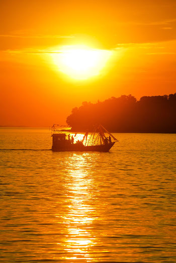 Sunset Sea Orange Color Gold Colored Sunlight Vacations Travel Destinations Scenics Beauty In Nature Travel Penyengat Island Decorative Ship Eyeem Select Sailing Tourism Landscape Boats⛵️ EyeEmNewHere Sailing Boat Stockphoto Silhouette Tropical Climate EyeEm Best Edits EyeEm Selects PenyengatIsland