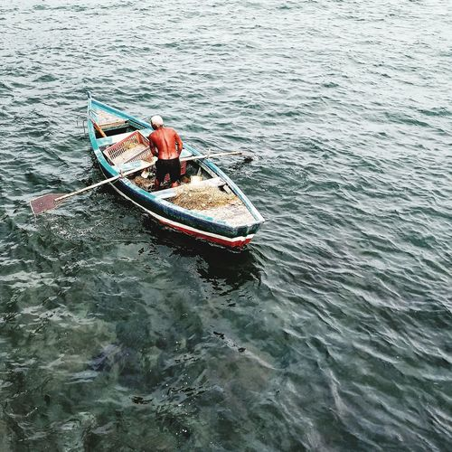 High angle view of fishing boat sailing in sea