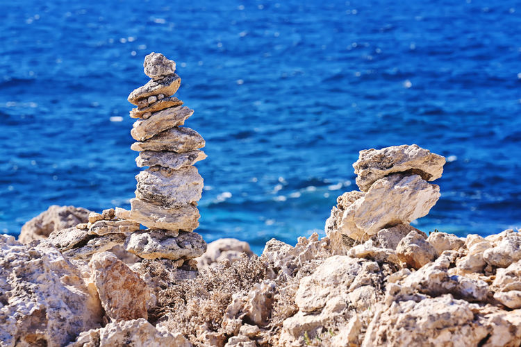 Zen pyramid of stacked rough stones on the blurred sea background. Concept of balance and harmony, nobody, copy space Stone Rock Stack Zen Balance Harmony Mindfulness Tranquil Heap Abstract Construction Symbol Closeup Sea Solid Heavy Simplicity Equilibrium Health Relax Pile Rubble Nature Texture Background Mountain Broken Peace Debris Calm Spa Beach Structure Wanderlust Yoga Hygge Imperfect  Stability Natural Concept Rough Relaxation Stacked Nobody Outdoor Pyramid Therapy Blue Beauty Summer