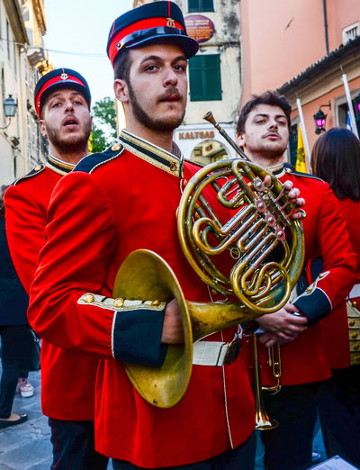 Brass Band French Horn Greek Islands Corfu Greece Men Military Military Uniform Music Musical Instrument Outdoors Parade Real People Red Travel Destinations Uniform