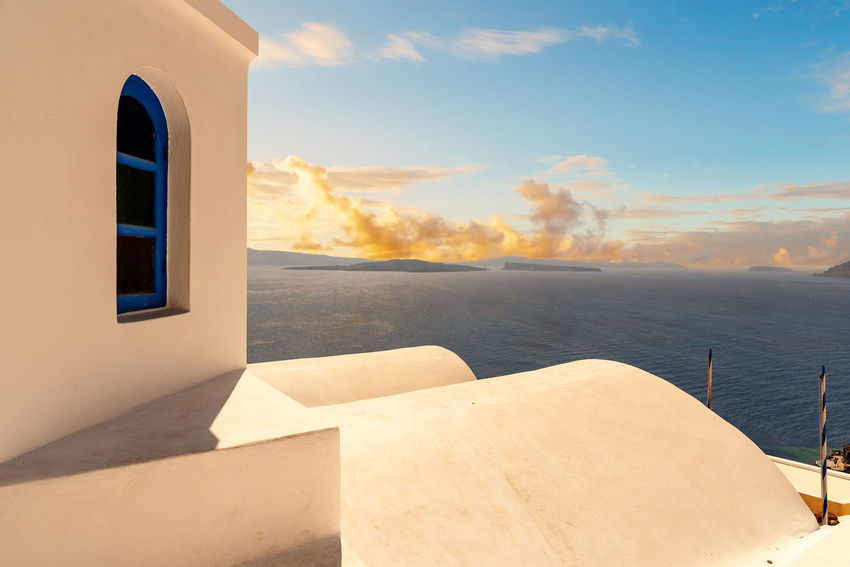 View of Oia - Santorini Cyclades Island - Aegean sea - Greece Greece Santorini Oia Cityscape Cyclades Island Mediterranean  Luxury Sea Cloud - Sky Water Built Structure Nature Architecture No People Building Exterior Beauty In Nature Scenics - Nature Sunlight Horizon Over Water Land Horizon White Color Building Sunset