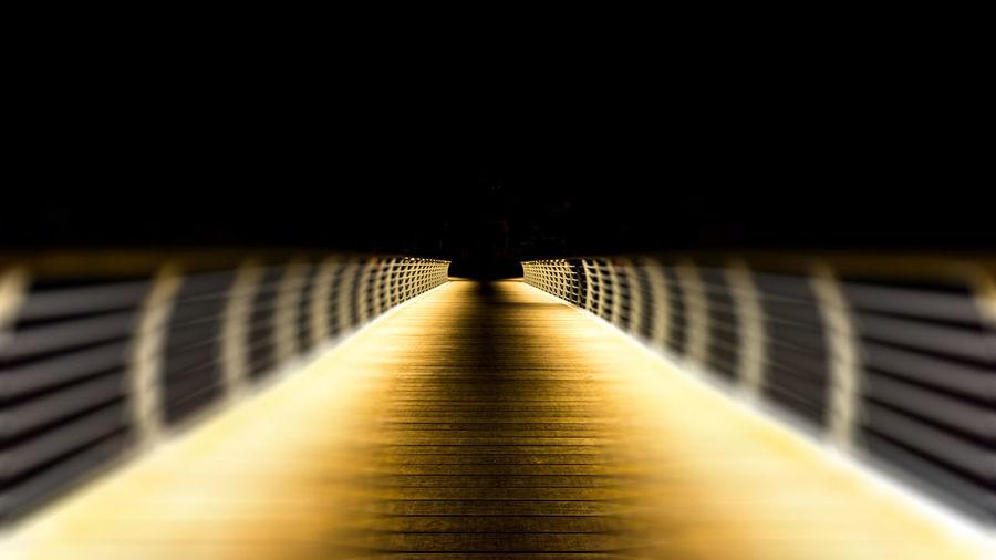 Empty footbridge in tunnel