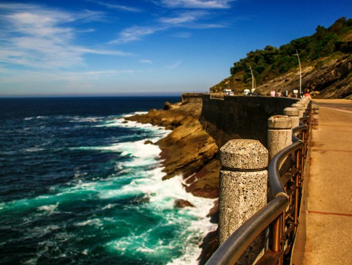Horizon Over Water Water Sea Tranquil Scene Beauty In Nature Calm Railing Wave Blue Waterfront Shore Nature Travel San Sebastian Donostia / San Sebastián Donosti  Paseo Maritimo Rocks And Water Waves Waves Crashing EyeEm Gallery Check This Out