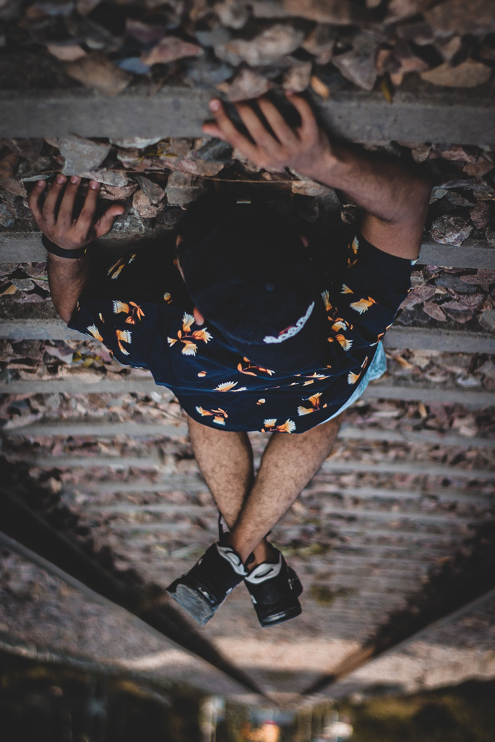 one person, real people, high angle view, lifestyles, leisure activity, full length, men, directly above, front view, nature, day, adult, casual clothing, outdoors, clothing, fashion, young adult, brick, standing, obscured face