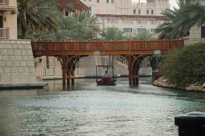 Dubai Ferry Madinat Jumeirah Middle East Travel UAE United Arab Emirates Architecture Boat Bridge - Man Made Structure Building Exterior Built Structure City Jumeirah Nature Nautical Vessel Outdoors River Tourism Transportation Travel Destinations Tree Water Waterfront