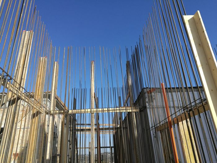 Incomplete buildings with scaffoldings at construction site
