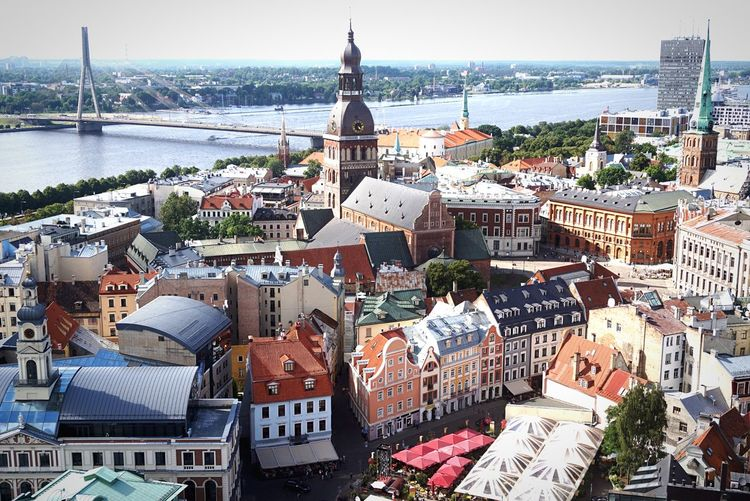St. Peter's Church UNESCO World Heritage Site Baltic Countries Observation Point Architecture Building Exterior Built Structure City High Angle View Building Cityscape Water Nature Day Crowd Sky Crowded Residential District Travel Destinations Travel Place Of Worship Outdoors TOWNSCAPE