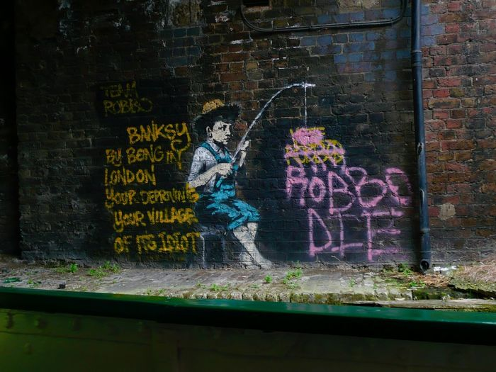 Banksy v. Team Robbo - London Text Brick Wall Wall Graffiti Art And Craft No People Day Architecture London Banksy Banksyart Team Robbo Robbo Travel Architecture Art ArtWork Canal Tourism Tourist Attraction  Travel Destinations EyeEmNewHere