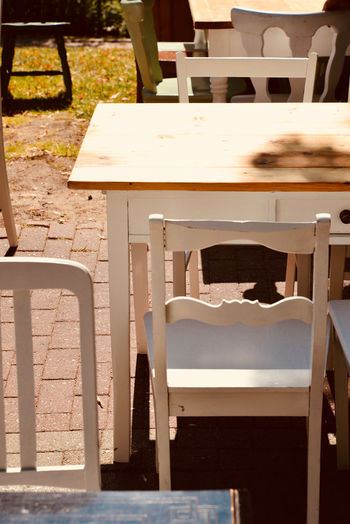 Absence Architecture Bench Business Cafe Chair Day Empty Focus On Foreground Furniture Nature No People Outdoors Relaxation Seat Shadow Sunlight Sunny Table Wood - Material