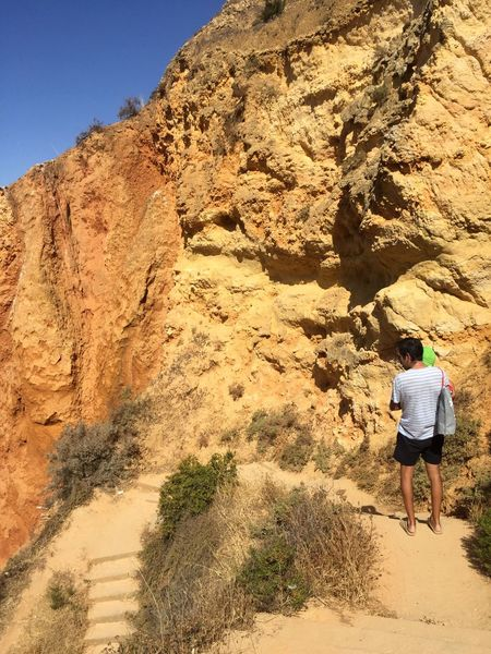 Rear View Real People Rock - Object Adventure Nature Leisure Activity Walking Rock Formation Arid Climate Scenics Day Lifestyles Full Length Men Beauty In Nature Mountain Physical Geography Hiking Landscape Outdoors Portugal Algarve Prainha The Week On EyeEm