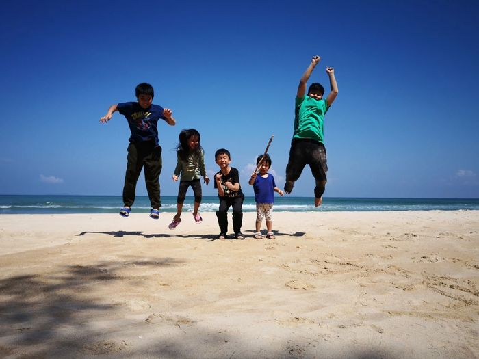 Jumping kids at the beach EyeEmNewHere Beach Beachphotography Beachlife Beach Life Playful Blue Sky Blue Blue Background Malaysia Paradise Vacation Holiday Infant Kids Sea Full Length Child Beach Happiness Sand Blue Childhood Boys Jumping Energetic Exhilaration Shore Stunt Cheering