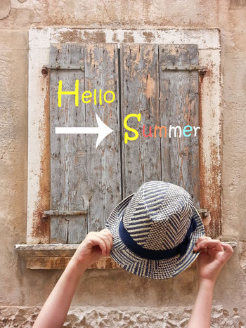 Hello summer concept on wooden window with hands and hat Concepts Hello Summer!  Adult Adults Only Architecture Backdrop Backgrounds Building Exterior Built Structure Communication Day Holding Human Body Part Human Hand Lifestyles One Person Outdoors People Real People Sea Space Text Women