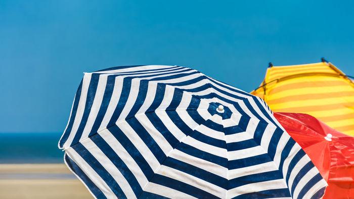 Striped beach umbrellas in a sunny day