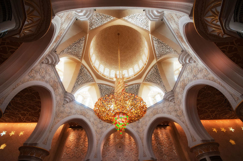 Low Angle View Of Chandelier Hanging From Ceiling In Mosque