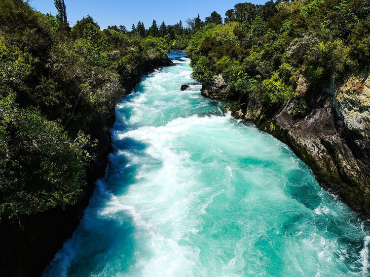 Huka Falls, New Zealand 🇳🇿 Waterfall Huka Falls New Zealand Travel Destinations Travel Photography Travel Water High Angle View Nature Beauty In Nature Outdoors Blue Day Motion Scenics No People Tree