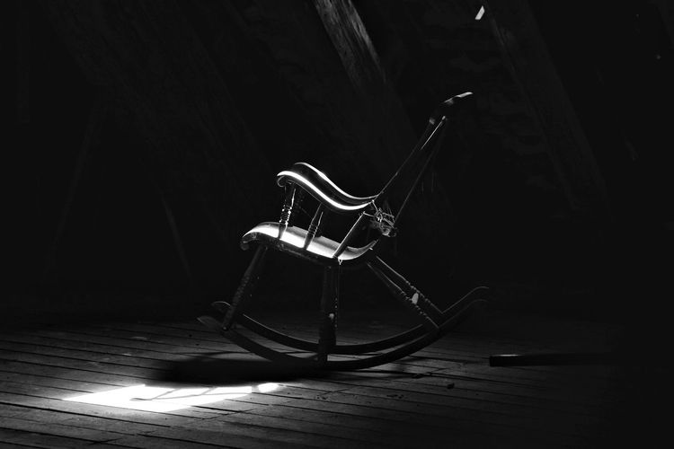 Rocking chair in the dark attic