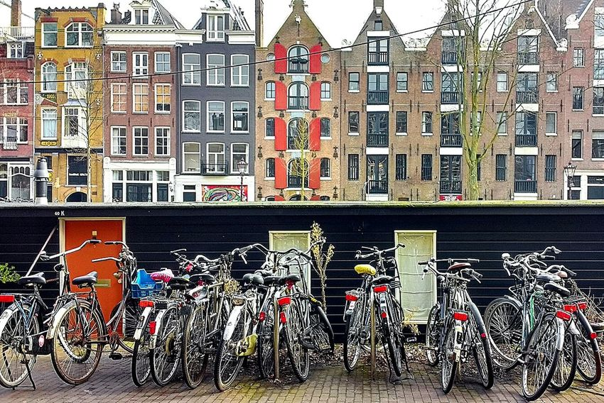 Bicycles Windows Architecture Building Exterior Built Structure Outdoors Day No People Amsterdamcity Amsterdam Bicycles Amsterdam Architecture Colors