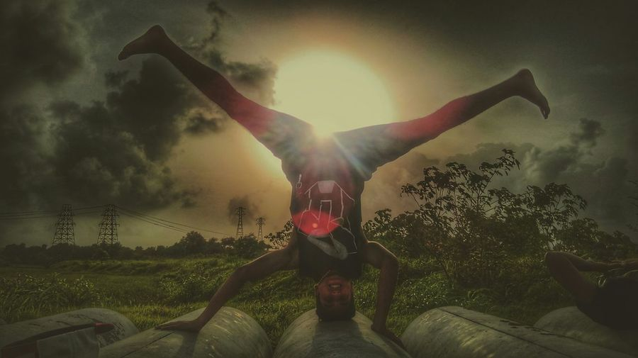 Mind My Head Wherever It Is Enjoying The Sun Sunset Headstand Clouds And Sky Cloudporn Love Peace EyeEm Best Shots The Action Photographer - 2015 EyeEm Awards