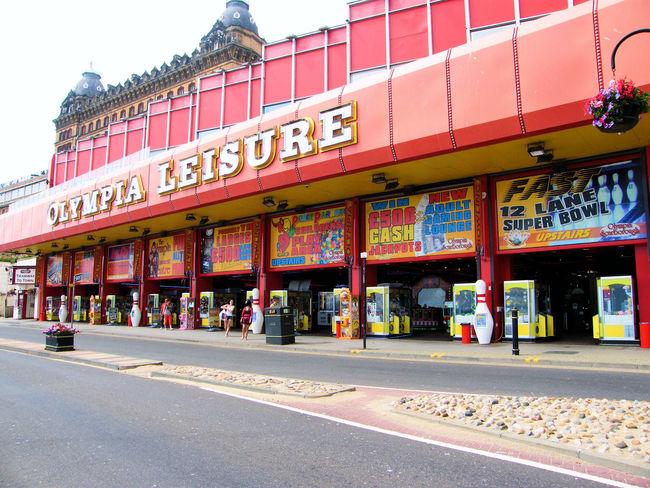 Coastal Town Scarborough Holiday Destination Tacky Shops Sea Front Seaside Amusement  Amusement Arcade Red Slot Machine Leisure Seaside Amusements Red Building