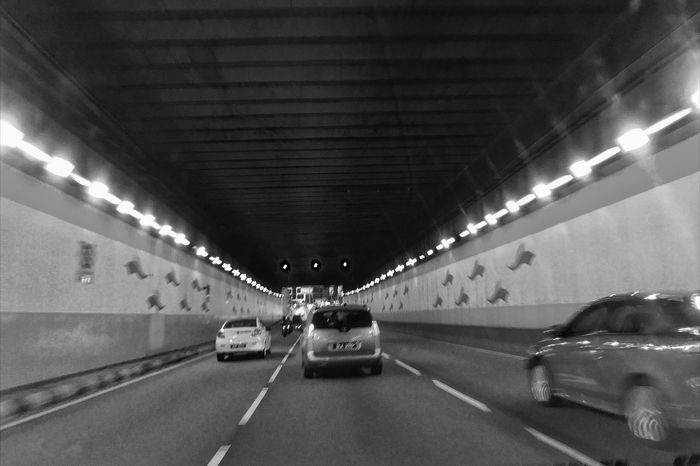 Tunnelling Car Transportation Illuminated Road Land Vehicle The Way Forward Lighting Equipment Tunnel Ceiling Mode Of Transport Built Structure Underground Night Architecture No People Indoors  Parking Garage