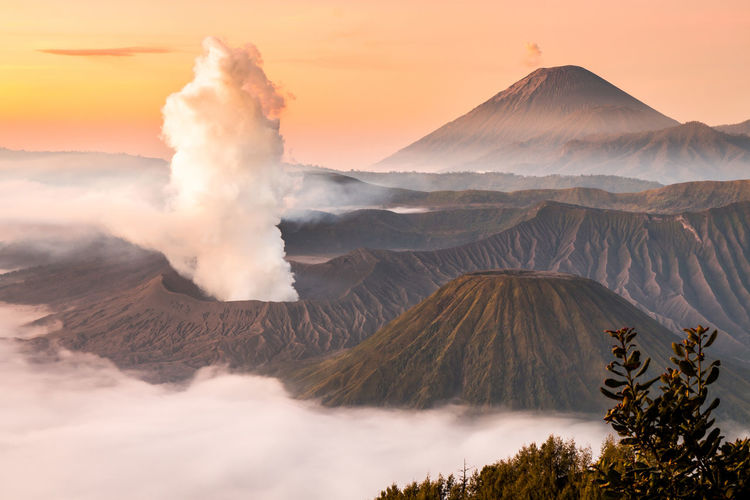 Landscape of Mount Bromo volcano, Batok and Semeru (Mt.) during sunrise from viewpoint on Mount Penanjakan located in Bromo Tengger Semeru National Park, East Java, Indonesia. Active Volcano Adventure Beatiful Nature Beauty In Nature Bromo Bromo Mountain Bromo Tengger Semeru National Park Crater Gunung INDONESIA Landmark Lanscape Mountain Mountain Range Mountain View Mountains Nature Outdoors Scenics Semeru Sunrise Sunset Viewpoint Volcanic Landscape Volcano
