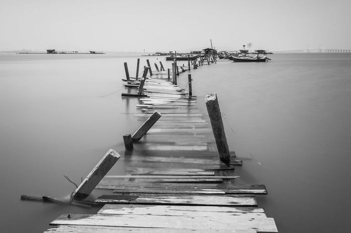Overflow broken wooden bridge view Classic Overflow Print Beauty In Nature Blacckandwhite Black And White Bridge Clear Sky Day Harbor Jetty Mode Of Transport Moored Nature Nautical Vessel No People Outdoors Pier Scenics Sea Shipyard Sky Tranquility Transportation Village Water Wooden