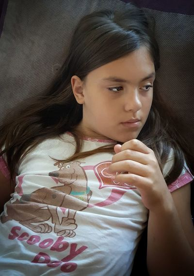 Close-up portrait of a girl looking away at home