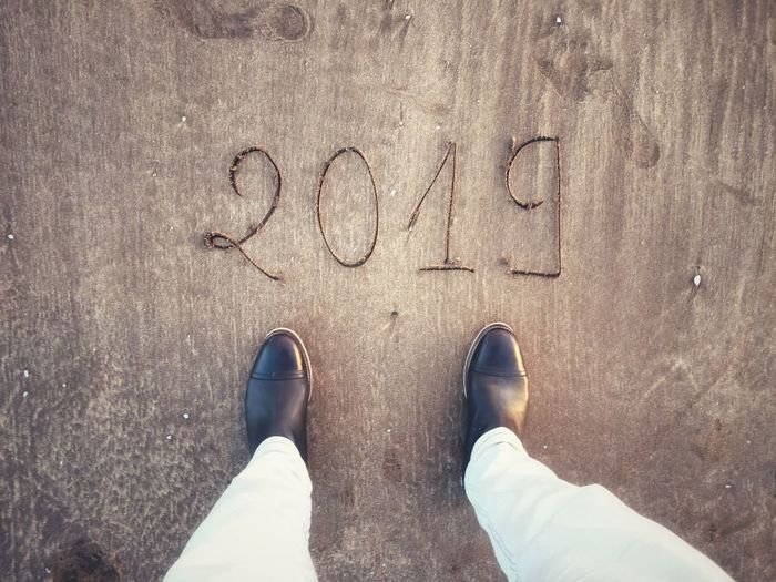 New Begining Feet New Year 2019 2019 New Year Low Section Text Shoe Human Leg Personal Perspective Standing Real People Body Part One Person Lifestyles Positive Emotion Land Men Communication Human Body Part High Angle View Western Script