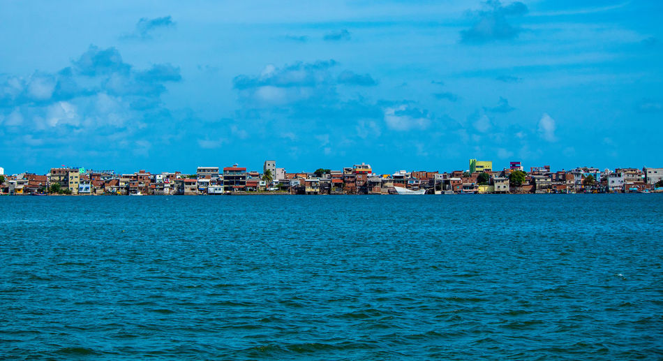 Hope between Sky and sea Favelabrazil Social Issues Favela Water Cityscape Sea Beach Blue City Harbor Nautical Vessel Waterfront Urban Skyline