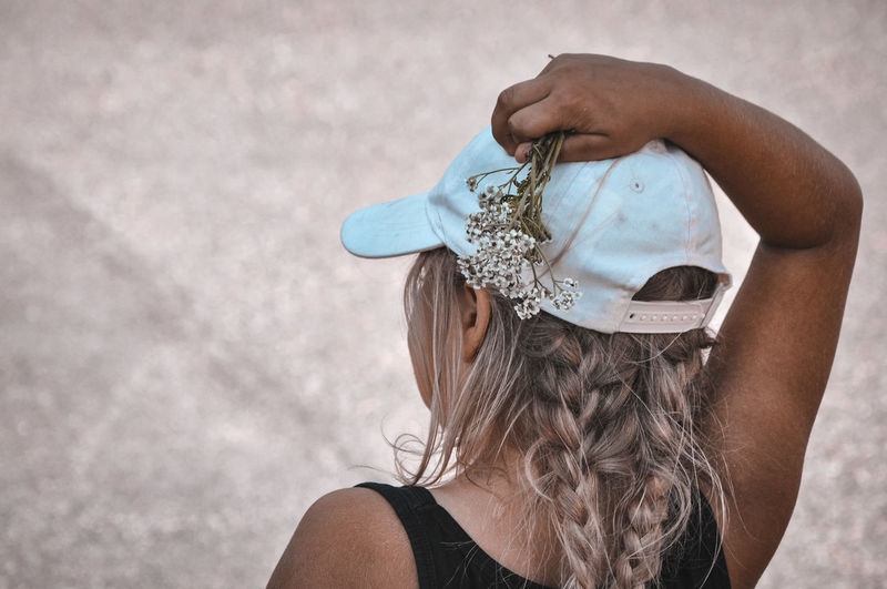 Rear view of girl wearing hat