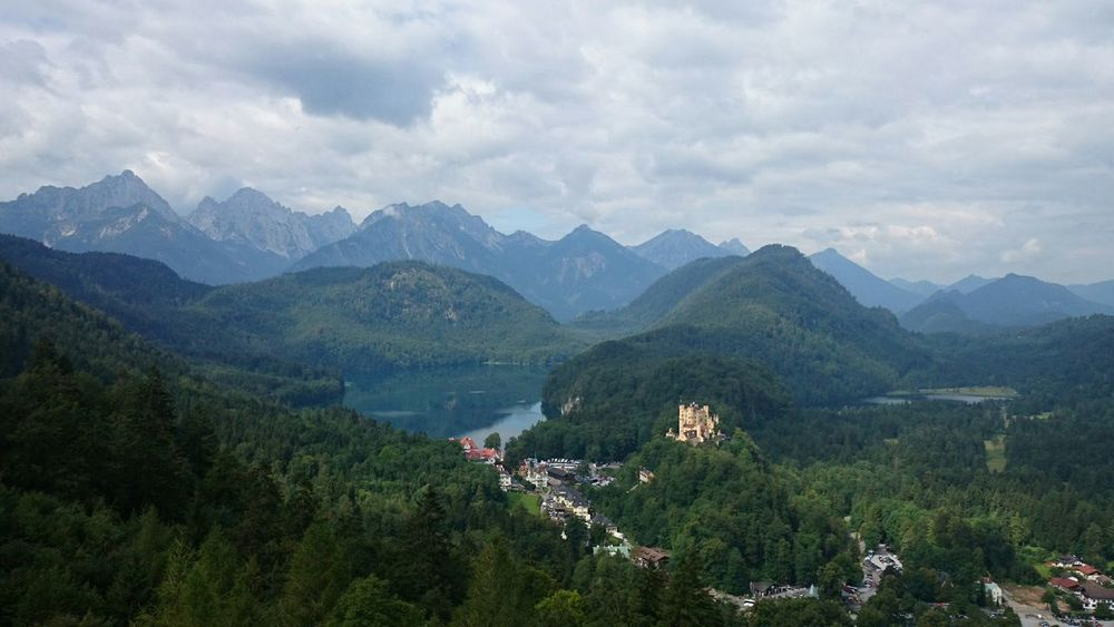 View from Neuschwanstein castle on Hohenschwangau Mountains Clouds And Sky