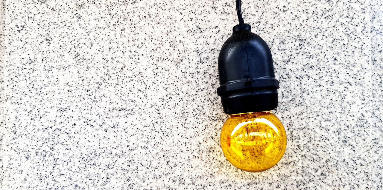 HIGH ANGLE VIEW OF OLD BOTTLE AGAINST WALL