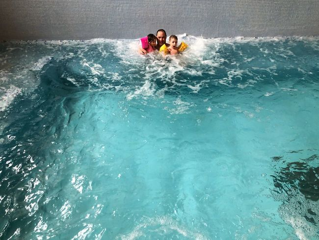 Family in swiming pool Childhood Children Parent Family Water Swimming Pool Togetherness Leisure Activity High Angle View Enjoyment