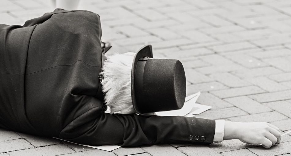 Man laying on ground during protest. Top Hat Monopoly Check This Out Enjoying Life Up Close Street Photography Random Discover Your City Blackandwhite Minneapolis Minnesota