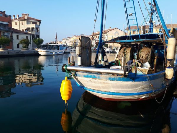 Nautical Vessel Water Transportation Mode Of Transport Reflection No People Harbor Outdoors Sky Day Sea Clear Sky Boat Boats And Water Fishing Boat Yellow Moored Nature Water Sea Habour Reflection Floating On Water