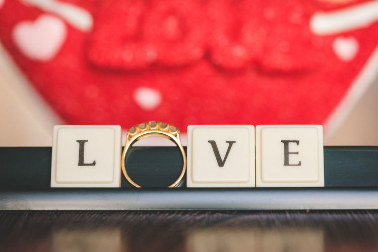 Text Communication Western Script Red Close-up Indoors  Capital Letter Letter No People Alphabet Still Life Focus On Foreground Number Selective Focus Love Table Wood - Material Heart Shape Emotion Single Word Ring