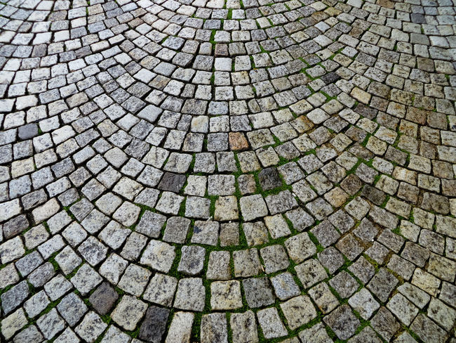 Abundance Backgrounds Close-up Cobblestone Curved  Beautifully OrganizedDesign Detail Elevated View Footpath Full Frame Geometric Shape Natural Pattern No People Outdoors Pattern Pavers Pivotal Ideas Repetition Sidewalks Stone Material Textured  Cobblestones Street Stone Pavement