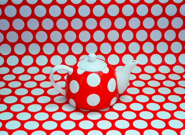I couldn't decide whether I preferred the top or the side view, so I'm posting both of them :) Backgrounds Pattern On Pattern Circles Best Shots Tea Pot Red And White Whitepolkadots Polkadots Side View Camouflaged Look Again Artistic Photography Arranged In Studio Single Object Nikon Pattern Pieces Pattern Photography Simple Artistic Background Camouflage Color Palette