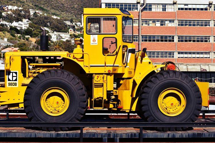 Construction vehicle against building