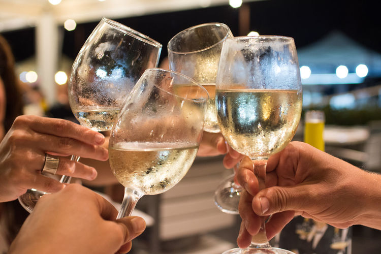 Cheers! Alcohol Celebration Celebratory Toast Cheers Drink Finger Focus On Foreground Food And Drink Friendship Glass Group Of People Hand Holding Human Body Part Human Hand Lifestyles Real People Refreshment Smiling Togetherness Wine Wineglass