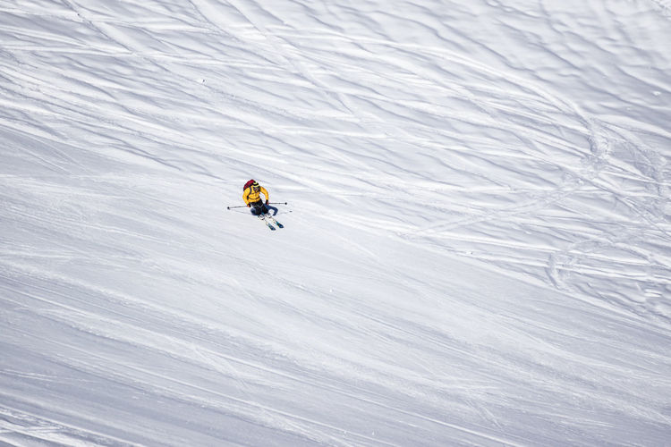 High angle view of person skiing on snowcapped landscape