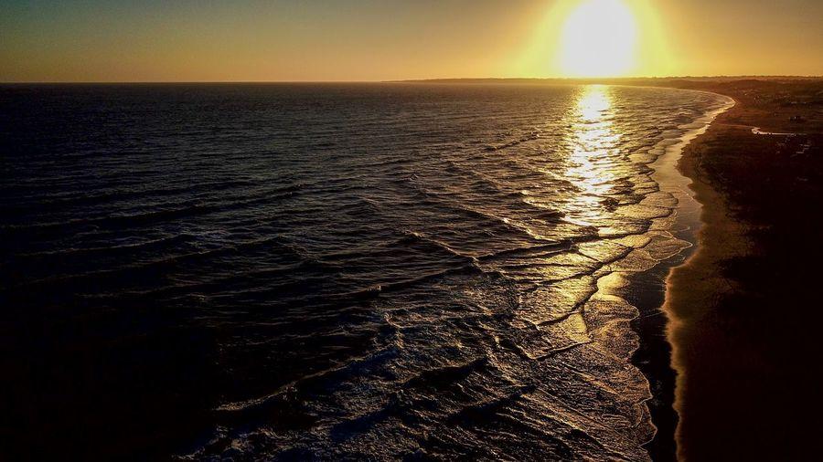 Water Sea Sky Sunset Scenics - Nature Beauty In Nature Horizon Horizon Over Water Tranquility Nature Tranquil Scene No People Sunlight Beach Land Idyllic Sun Reflection Outdoors