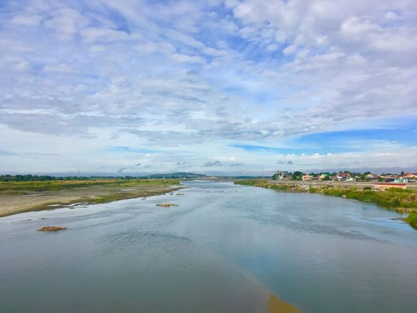 On Gilbert Bridge, Laoag City Philippines Scenics Beauty In Nature Tranquility Landscape Water Outdoors Sky Tranquil Scene Travel Ilocosnortephilippines Tourism IPhone IPhone Photography Nature Laoag City Philippines